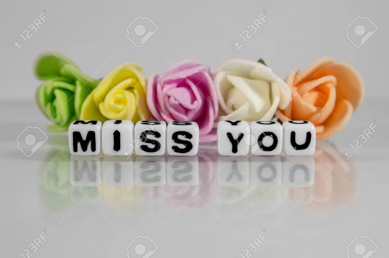 Miss you text with flowers Stock Photo - 45917113