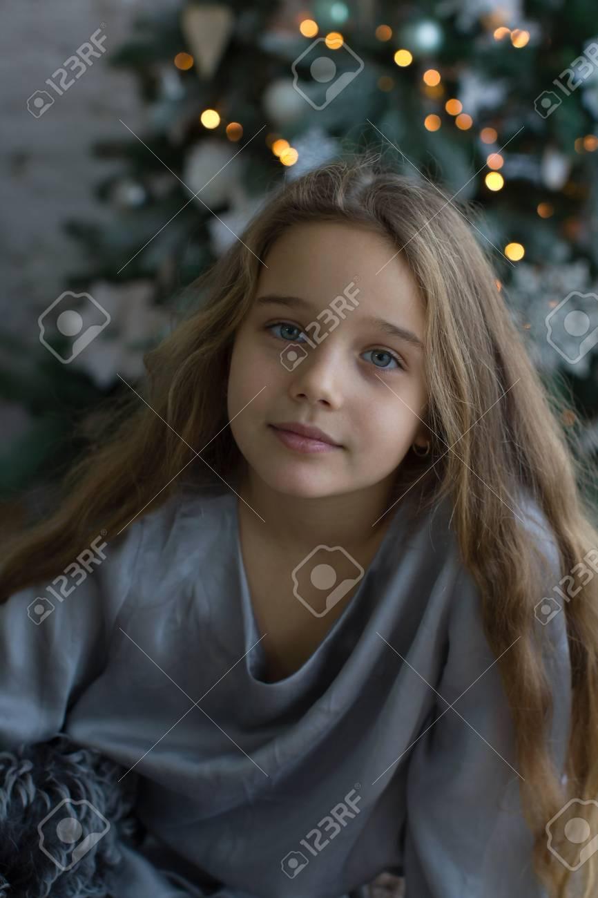 Amazingly beautiful girl on the background of the Christmas tree. Christmas Holidays. - 69564349