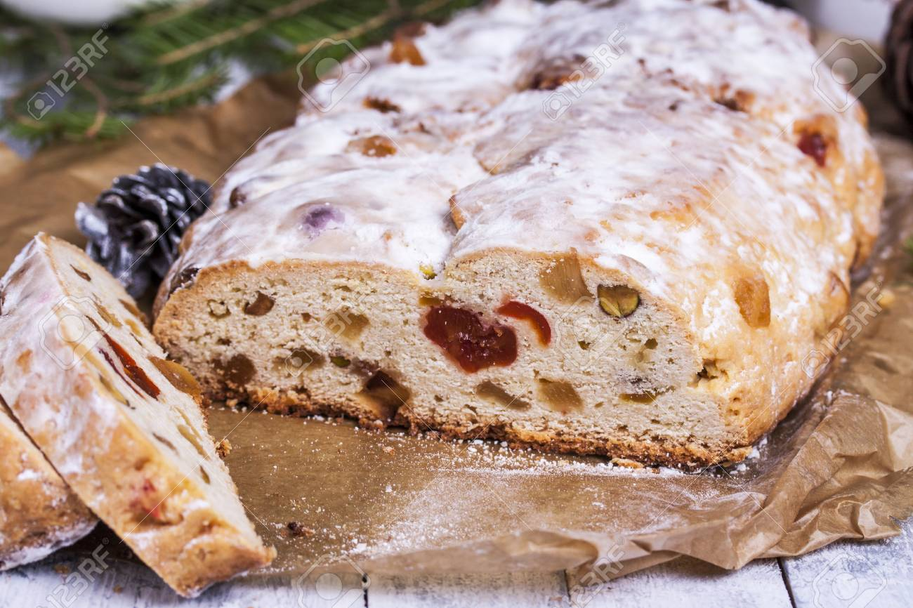 german christmas cake stollen with dry fruits and nuts close up on the table stock photo