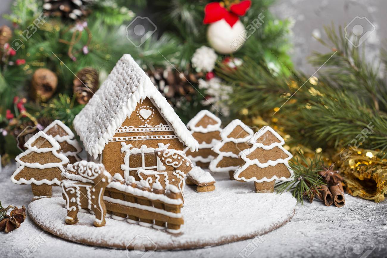 little homemade gingerbread house with christmas decorations stock photo 92707024