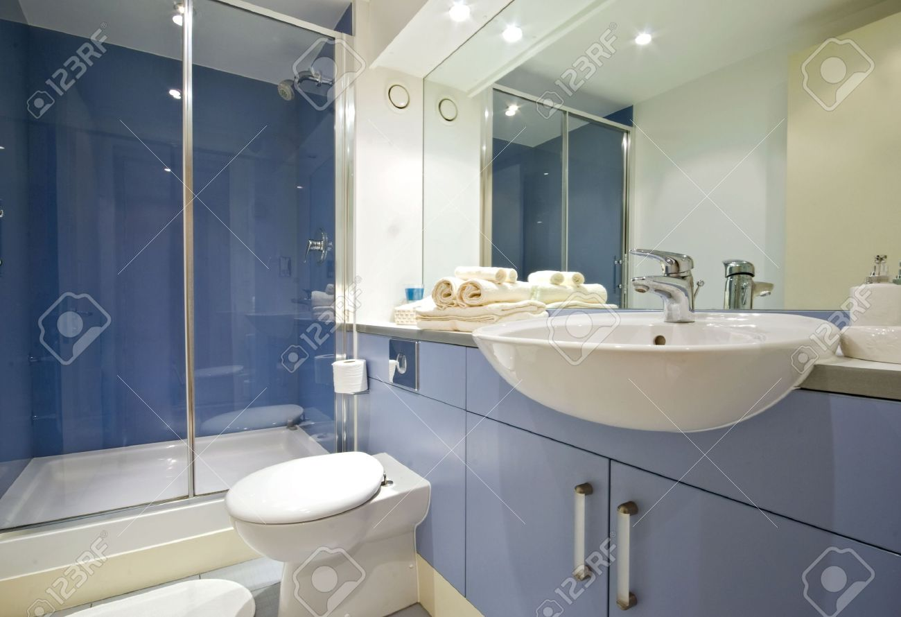 modern blue bathroom with shower cabin stock photo picture and