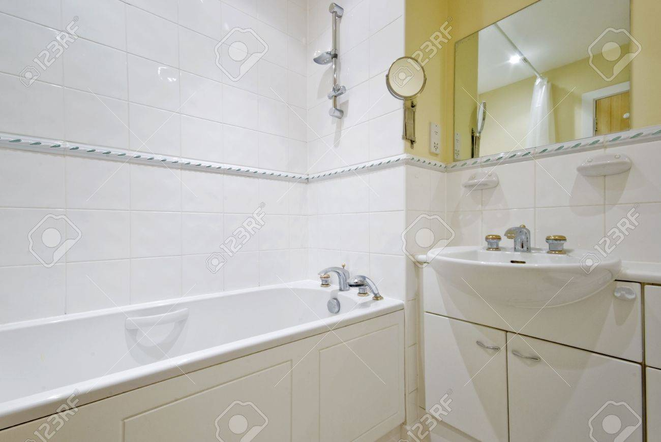 Classic Bathroom In Yellow Wall Paint And White Tiles Stock Photo ...