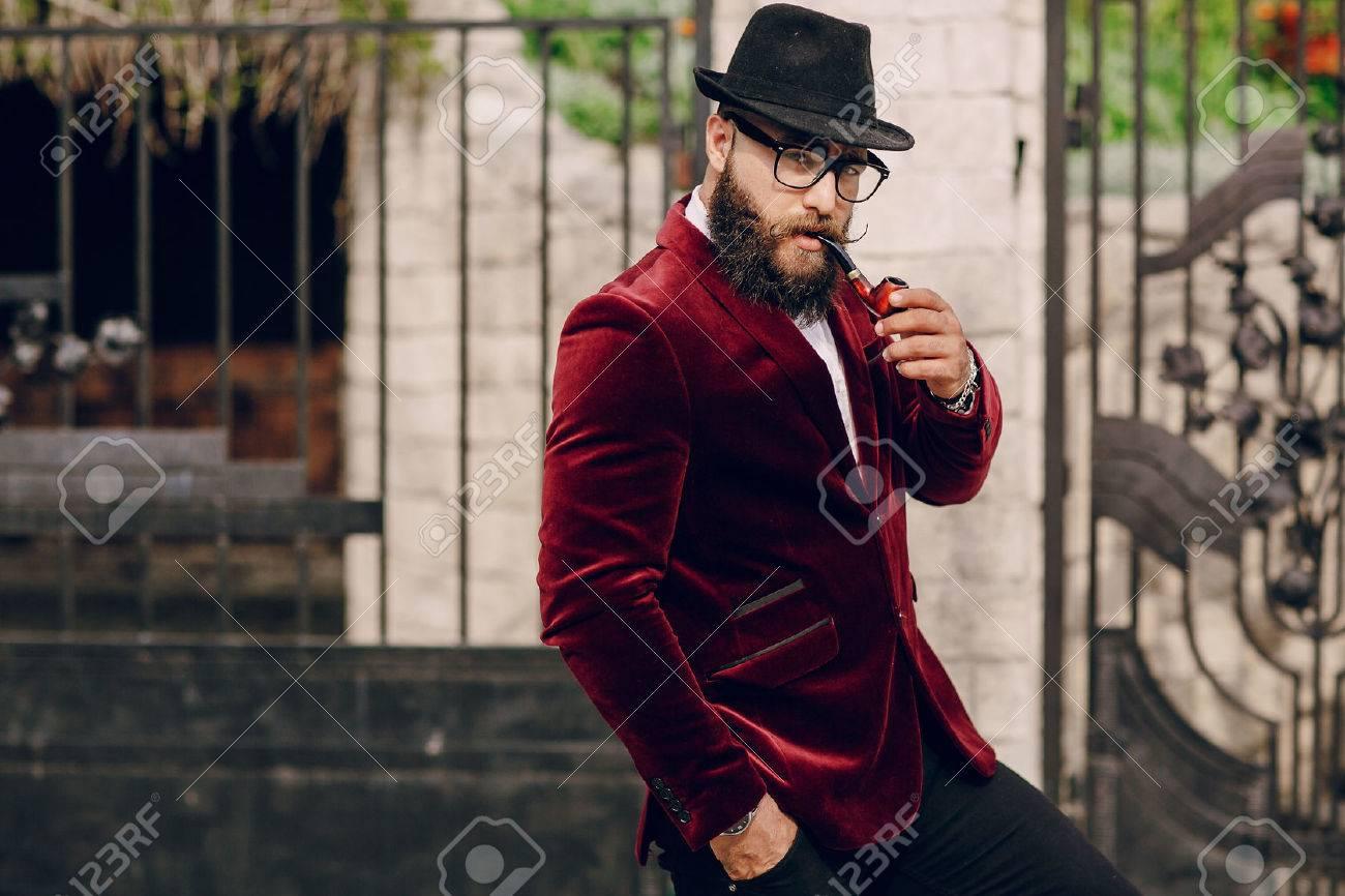 refined bearded man who looks like a millionaire - 43380868