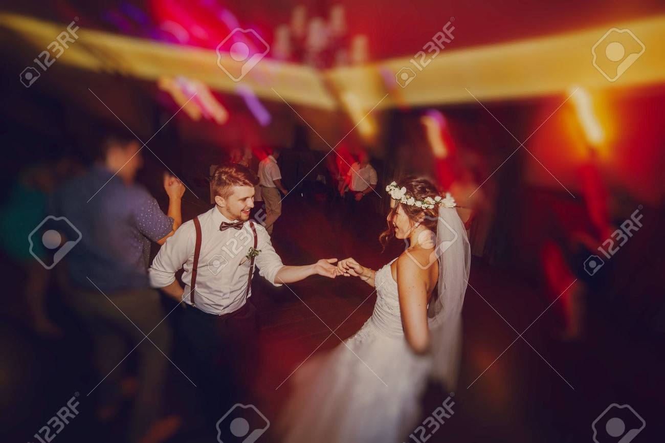 wedding couple in a restaurant celebrating her wedding day - 49499889