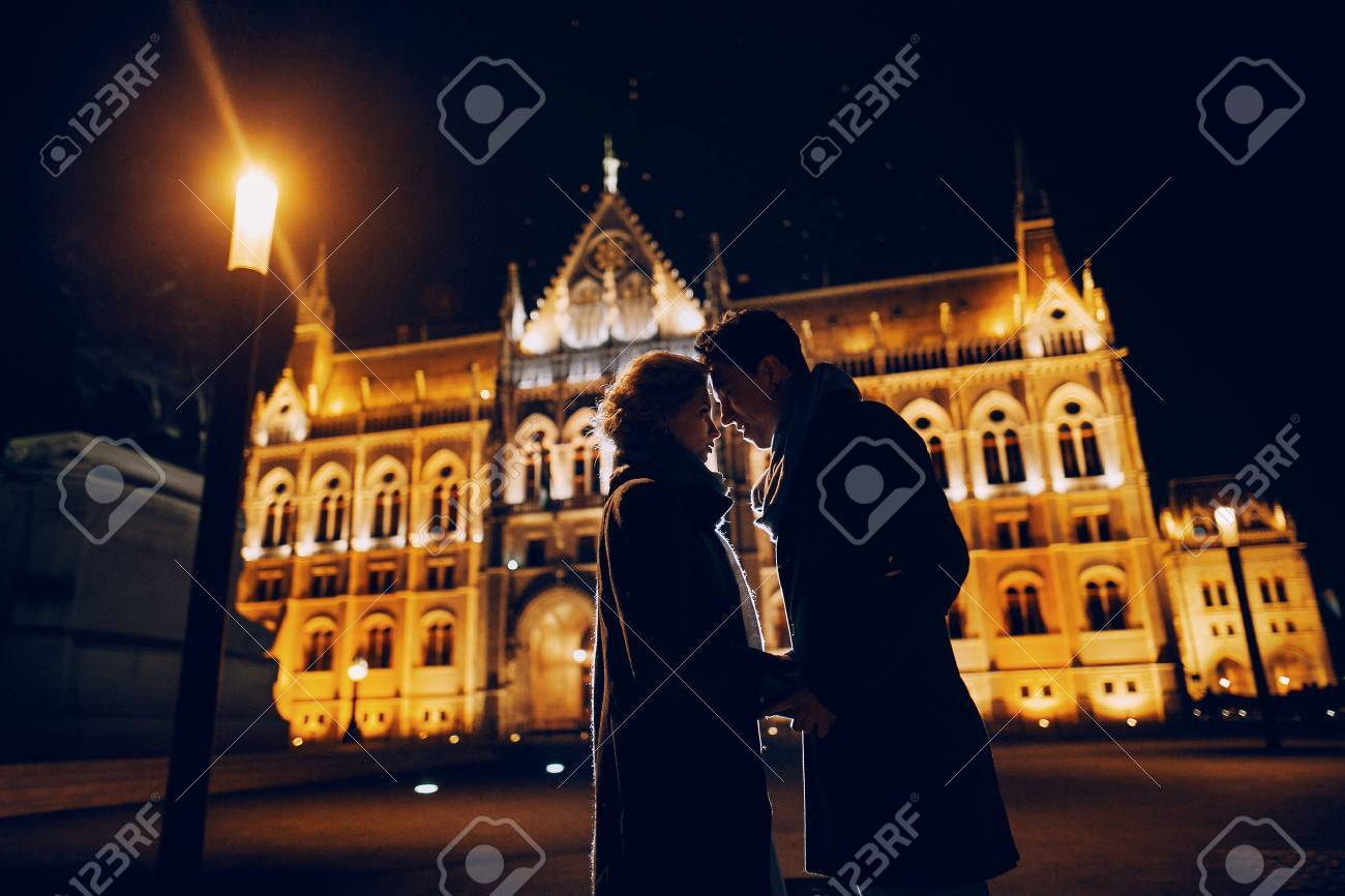 gorgeous wedding couple walking in Budapest at night - 52916425