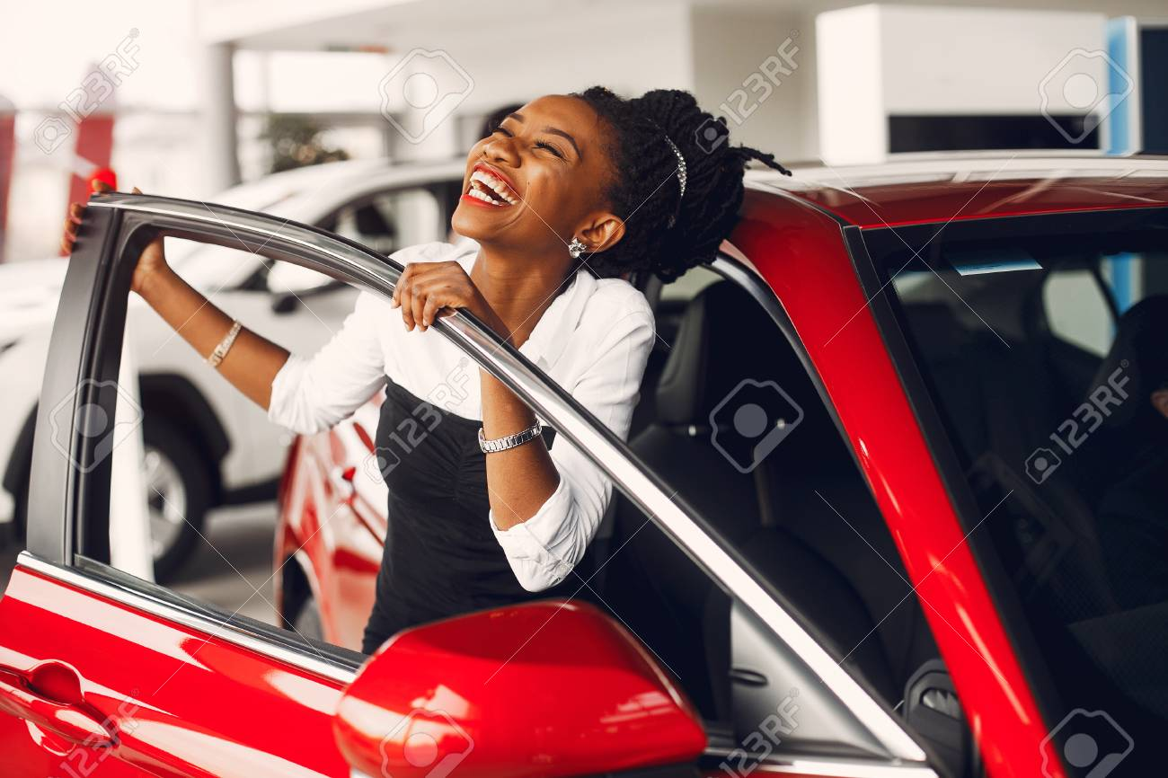 Stylish black woman in a car salon - 122935538