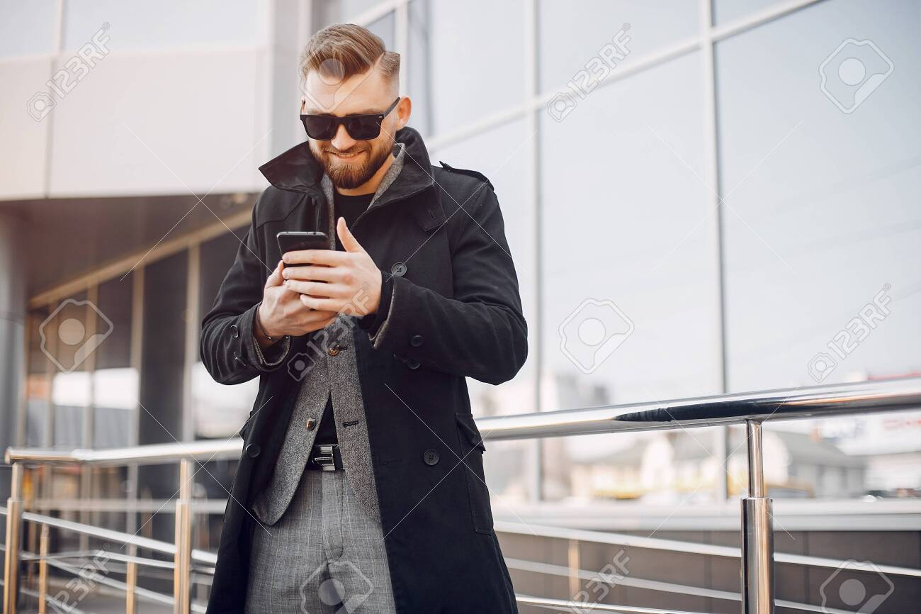 Man in a stylish suit. Businessman in a summer city - 135990078