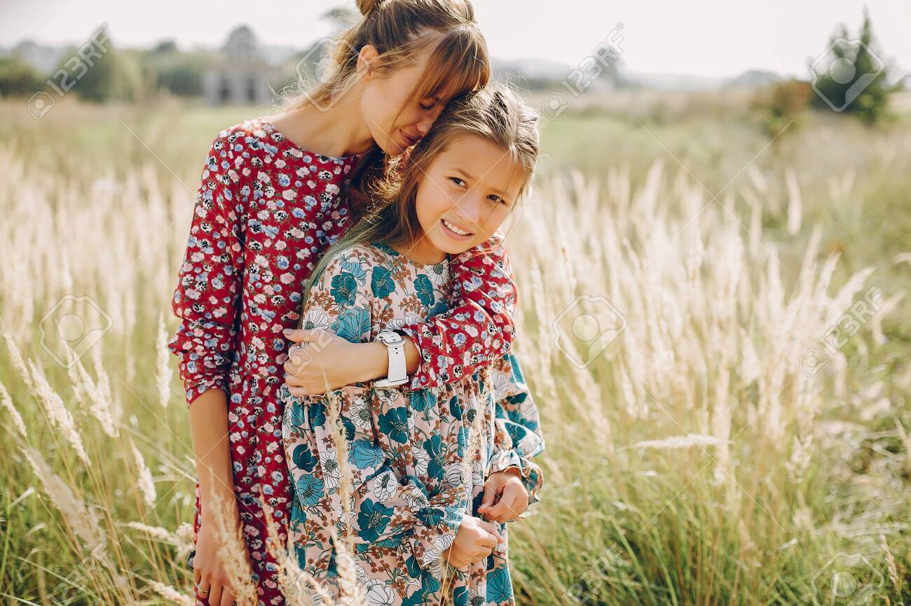 Cute and stylish family in a summer field - 139097641