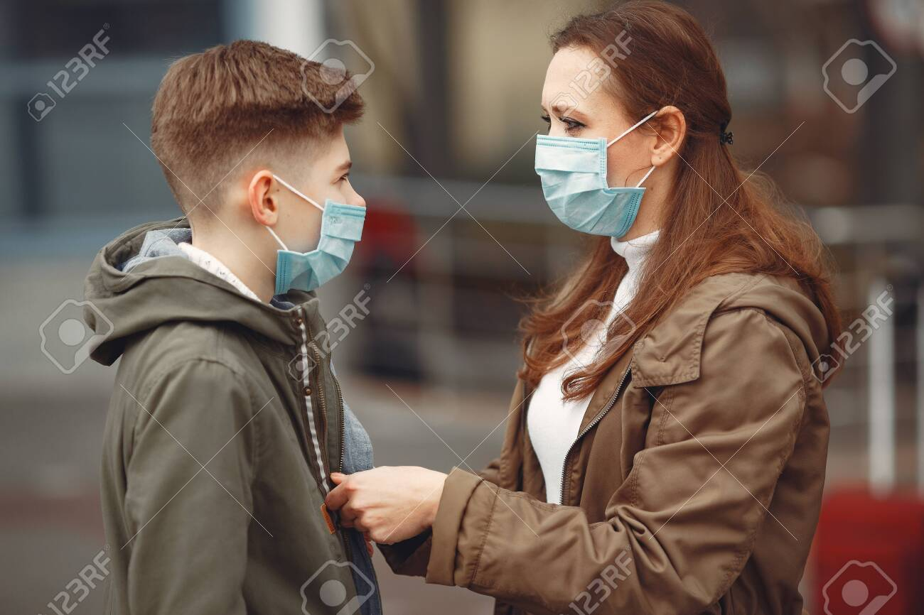 A boy and mother are wearing protective masks - 142135873