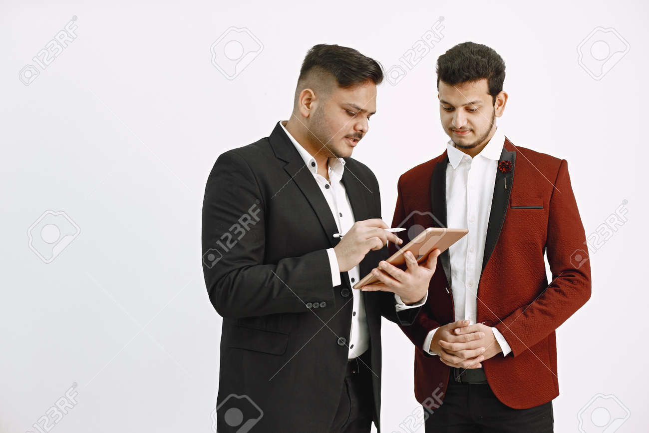 Two men in official costumes discussing something isolated - 169106365