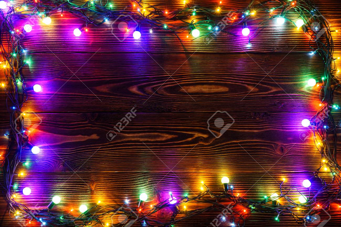 stock photo wreath and garlands of colored light bulbschristmas background with lights and free text space christmas lights border