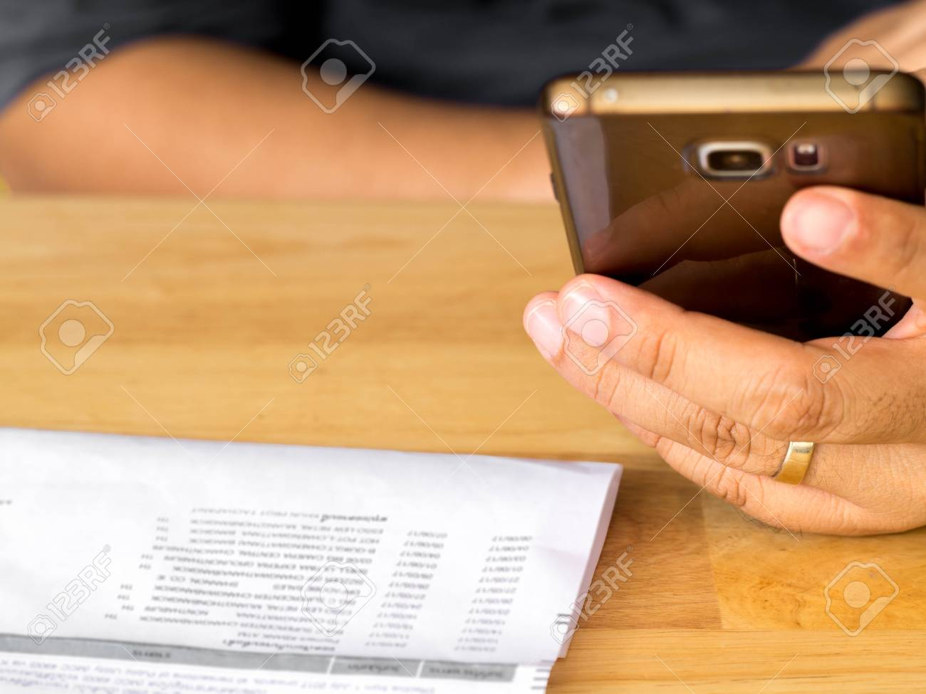 A Man Holding Smart Phone For Using Online Banking App For Paying Credit  Card Bill.