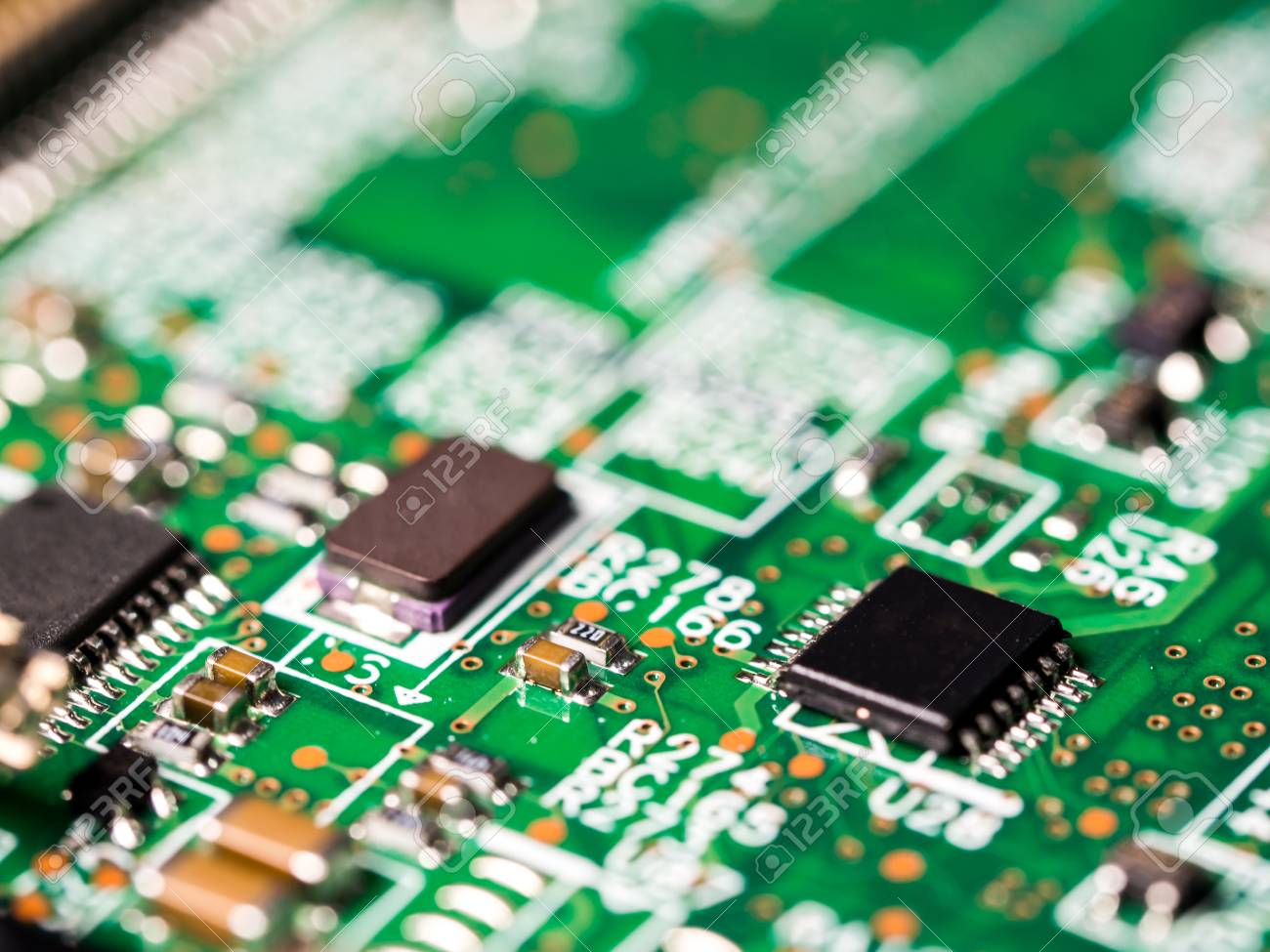 Close-up Of Circuit Board With Integrated Circuits, Resistors ...