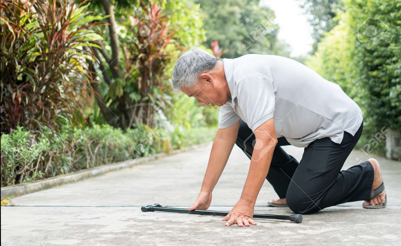Asian senior man falling down at home in the backyard caused by myasthenia (Muscle Weakness) and the nurse came to help support. Concept of old elderly insurance and health care - 157491108
