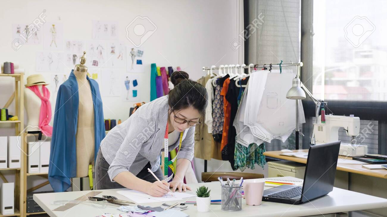 Fashion Designer Working On Designs In Studio Asian Female Employee Stock Photo Picture And Royalty Free Image Image 126710846