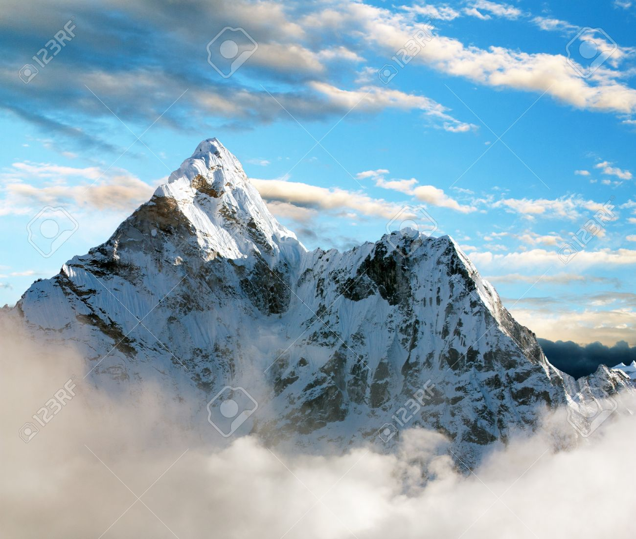 Beautiful view of Ama Dablam with and beautiful clouds - Sagarmatha national park - Khumbu valley - Trek to Everest base cam - Nepal - 27133747