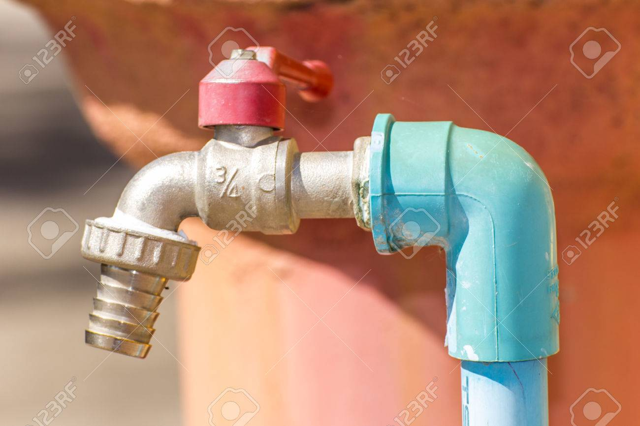 Red Faucet With Water Mains Stock Photo, Picture And Royalty Free ...