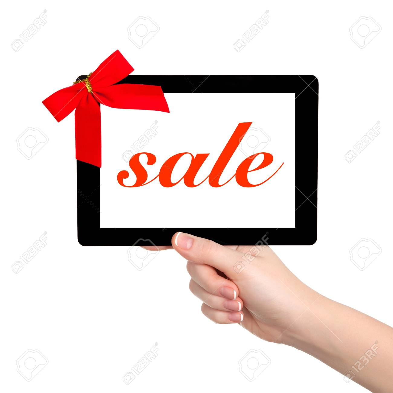 female hands holding a tablet touch computer gadget with isolated screen and a red gift bow Stock Photo - 17512710