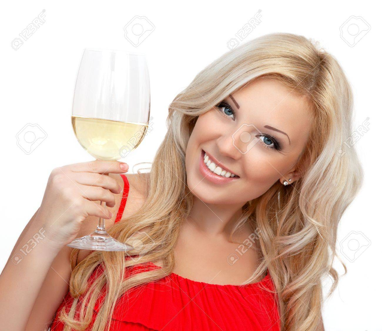 portrait of a beautiful blonde girl in a red dress with a glass of wine for the holiday Stock Photo - 18137983