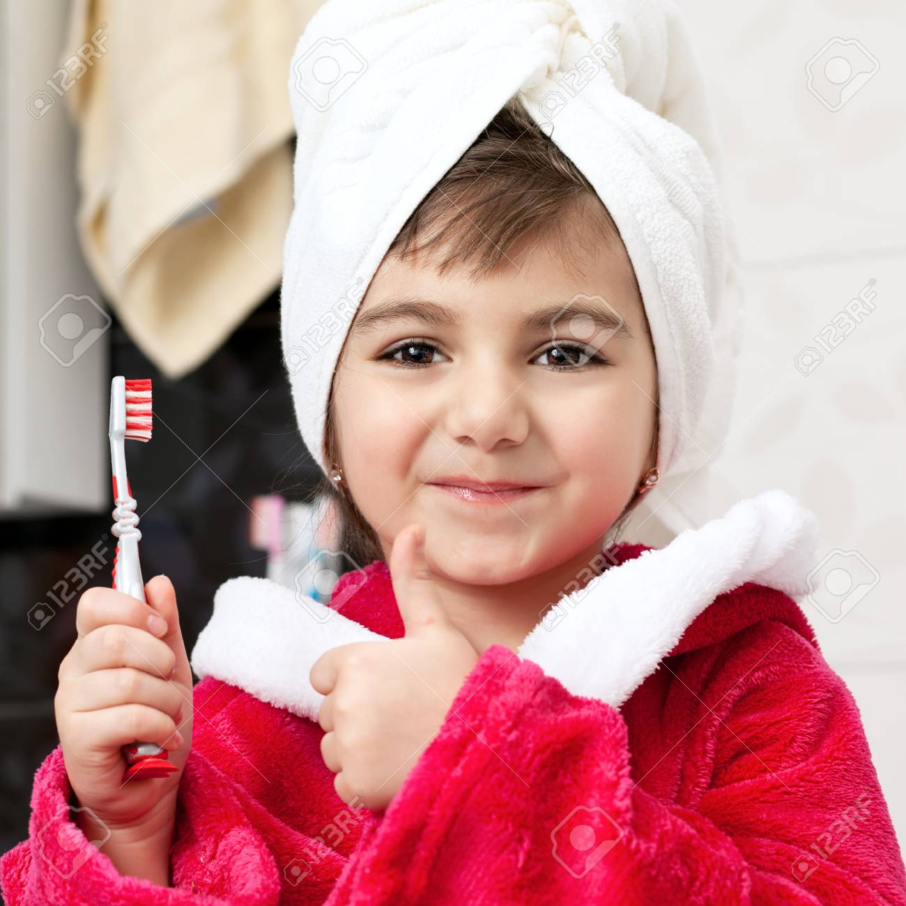 little girl in the bathroom with a toothbrush Stock Photo - 18178609