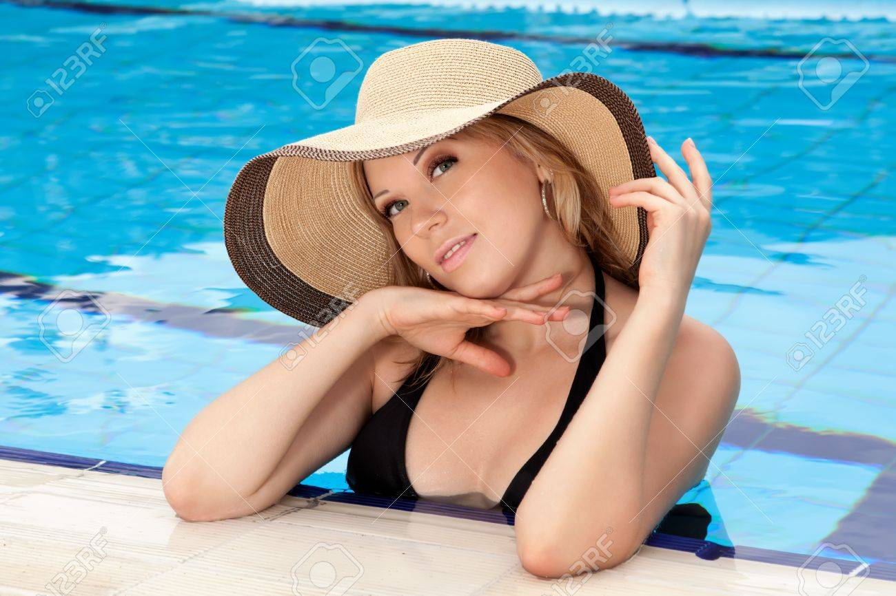 series closeup portrait the smart blonde in a hat in pool of expensive hotel Stock Photo - 18525170