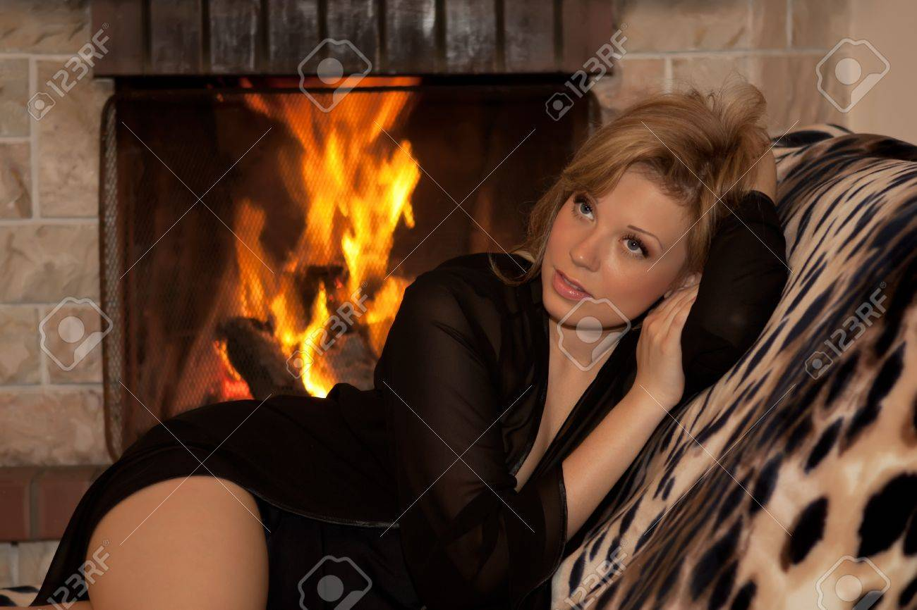 beautiful lying near a burning fireplace in the cozy house