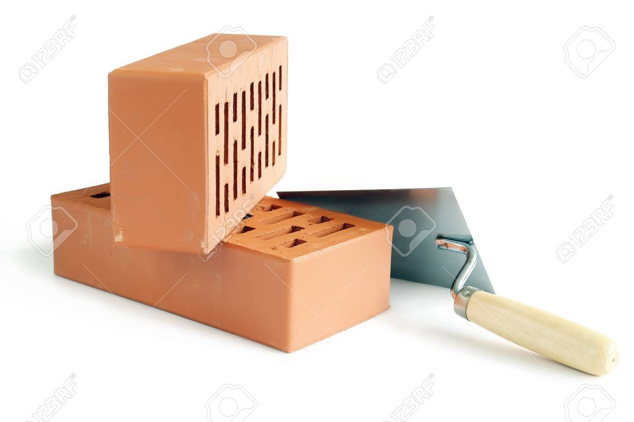 Two perforated bricks and stainless steel trowel isolated on white Stock Photo - 1148696