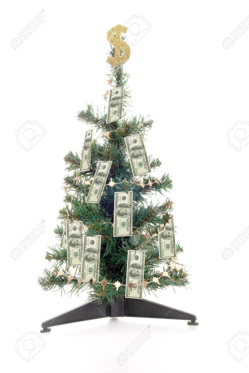 foto de archivo rbol de navidad decorado con cien billetes de dlar de oro y signo de dlar en la parte superior sobre fondo blanco