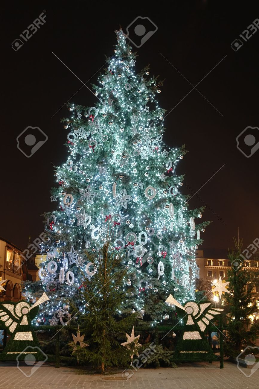 Outdoor christmas tree decorations - Outdoor Christmas Tree Decorated With Lights Illuminated At Night Stock Photo 2211378