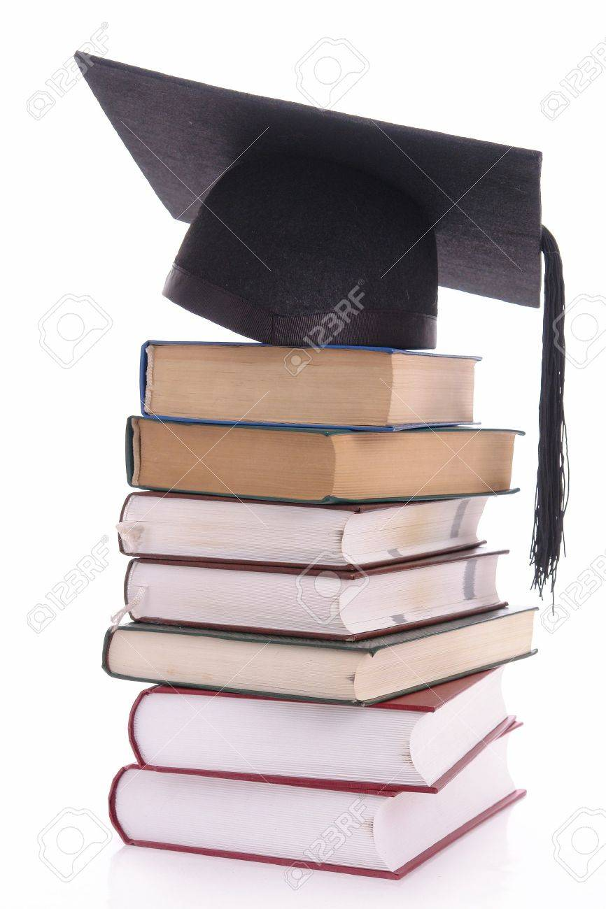 Black graduation cap on pile of books over white Stock Photo - 4007883