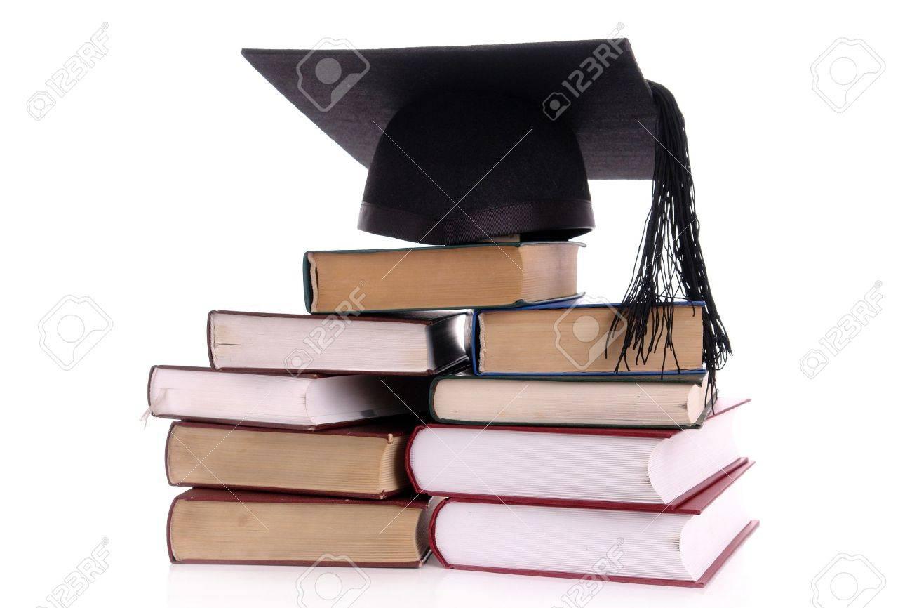 Black graduation cap on pile of books over white Stock Photo - 4029516