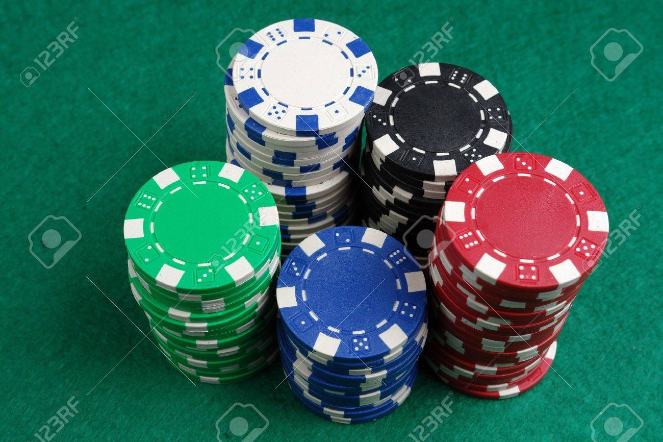Piles of casino chips on green table cloth Stock Photo - 4029523