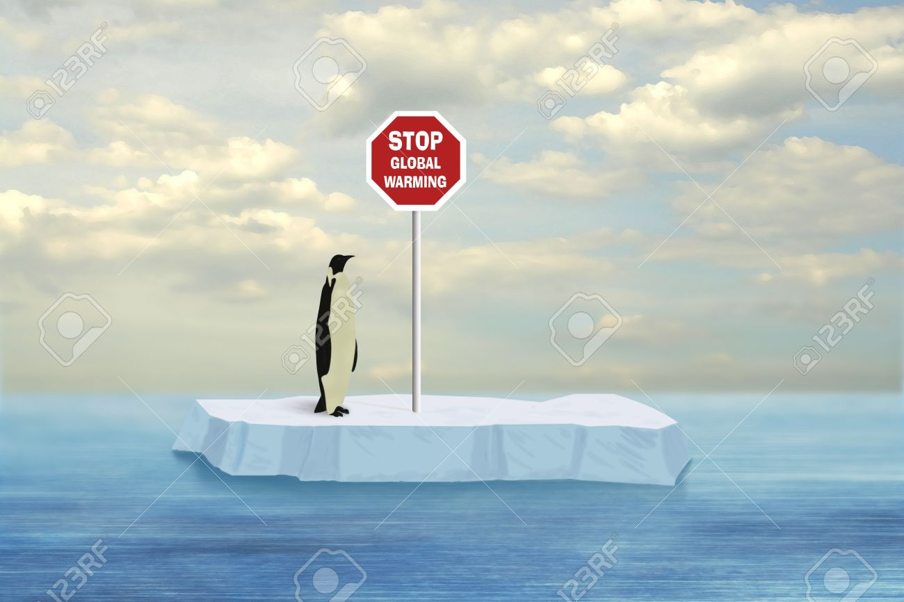 Penguin looking at Stop Global Warming sign driven into floe floating on the Artctic sea surface Stock Photo - 4074040