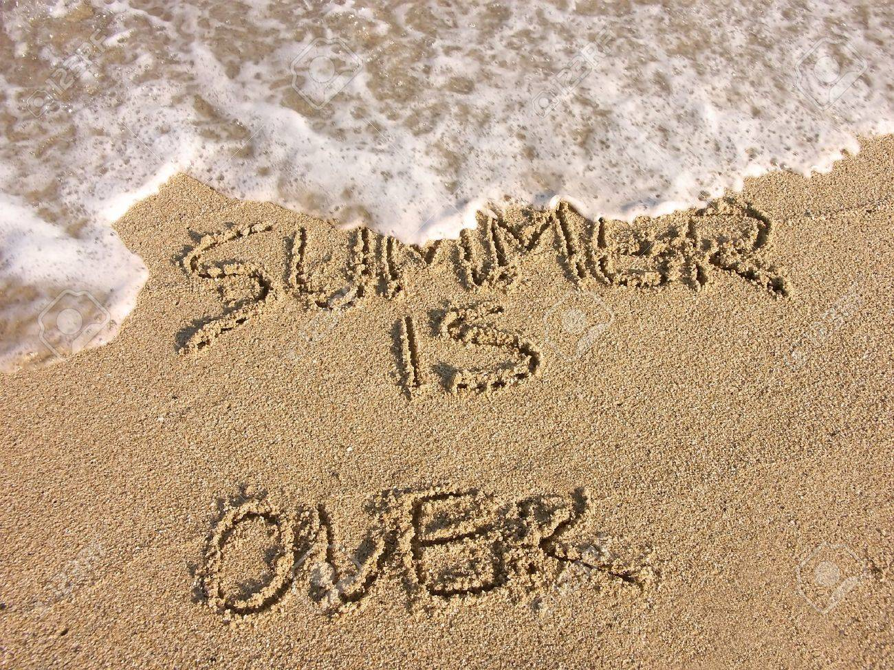 Summer is over - handwriting on the beach sand Stock Photo - 4083891