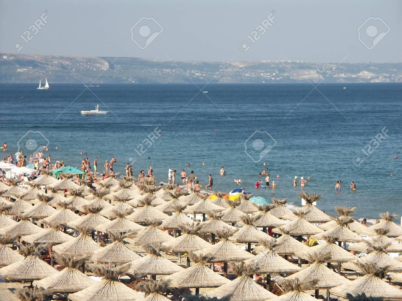 Golden Sands beach with rows of straw shade umbrellas in Bulgaria Stock Photo - 4187755