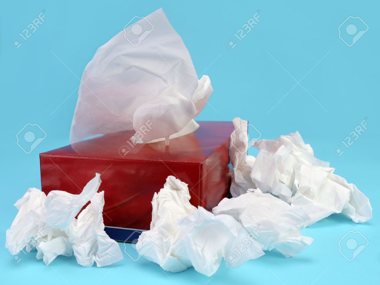 Paper tissue box with used tissues over light blue background Stock Photo - 4431642