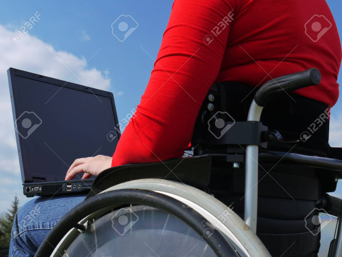 Handicapped woman on wheelchair using laptop outdoors Stock Photo - 4802028