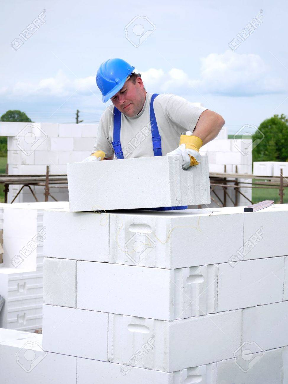 Mason building house walls from white aerated autoclaved concrete blocks Stock Photo - 4984560