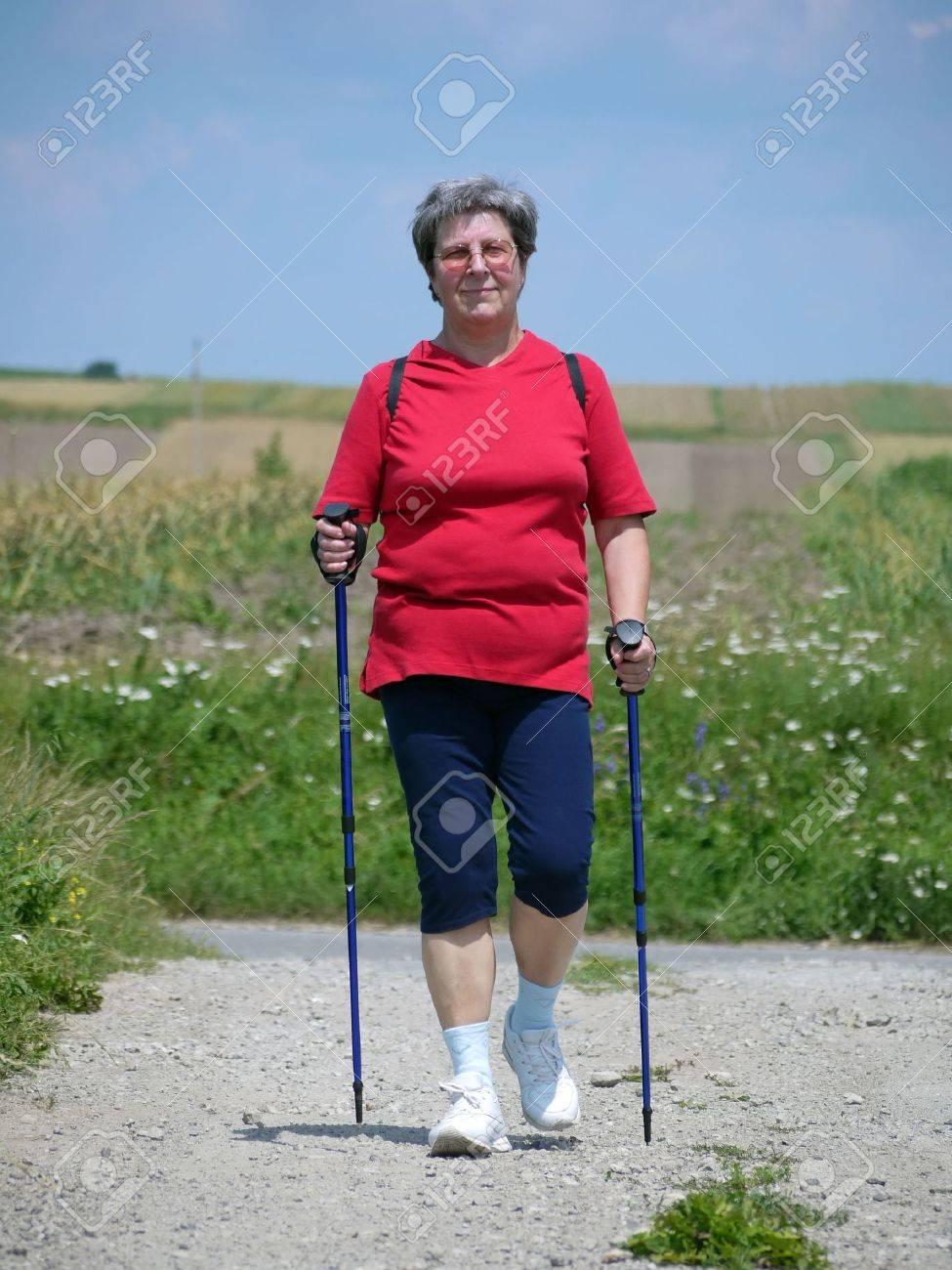 Senior woman practising nordic walking in the countryside Stock Photo - 5141939