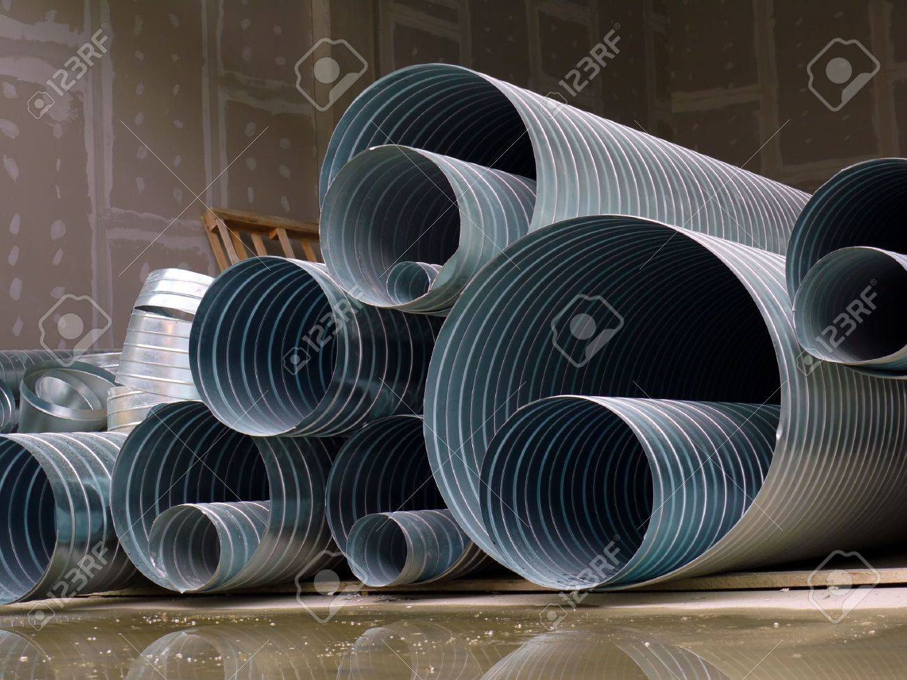 Pile of steel corrugated pipes stacked at construction site Stock Photo - 5238906