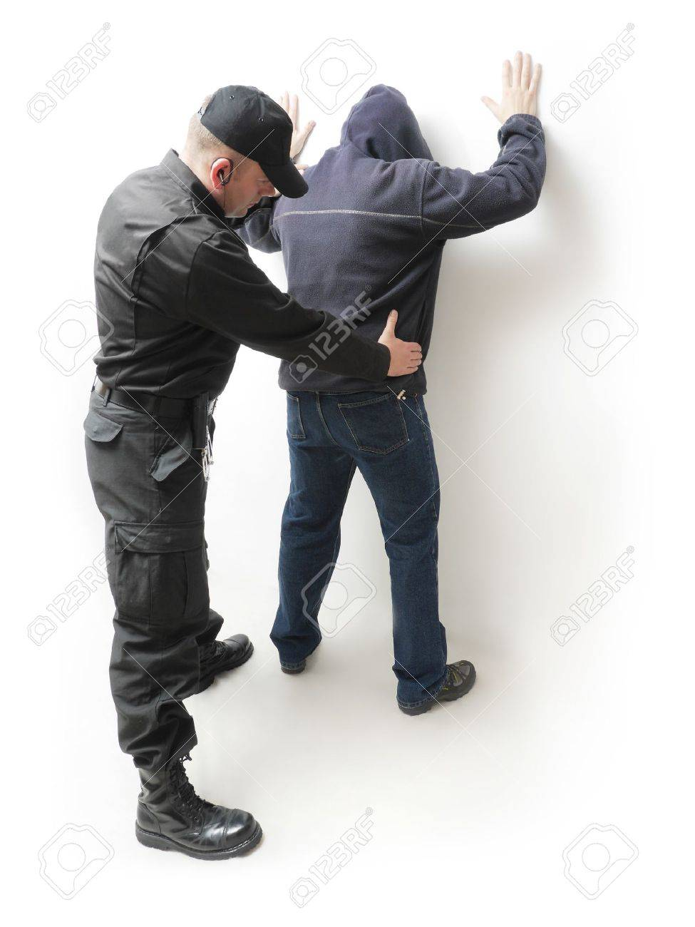 Man being searched by a policeman in black uniform Stock Photo - 25987963