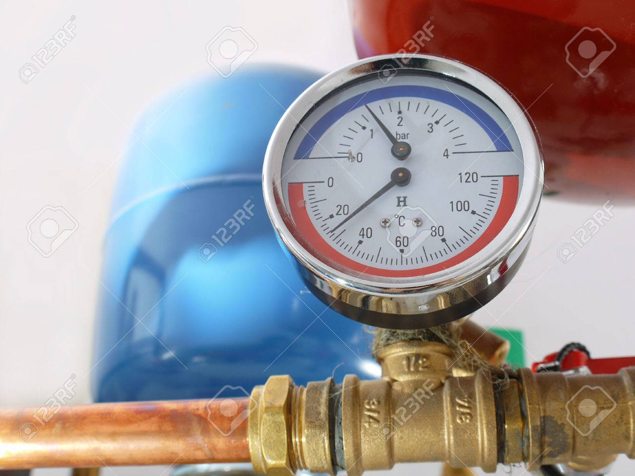 Temperature And Pressure Gauge Mounted On Boiler Pipes Stock Photo ...