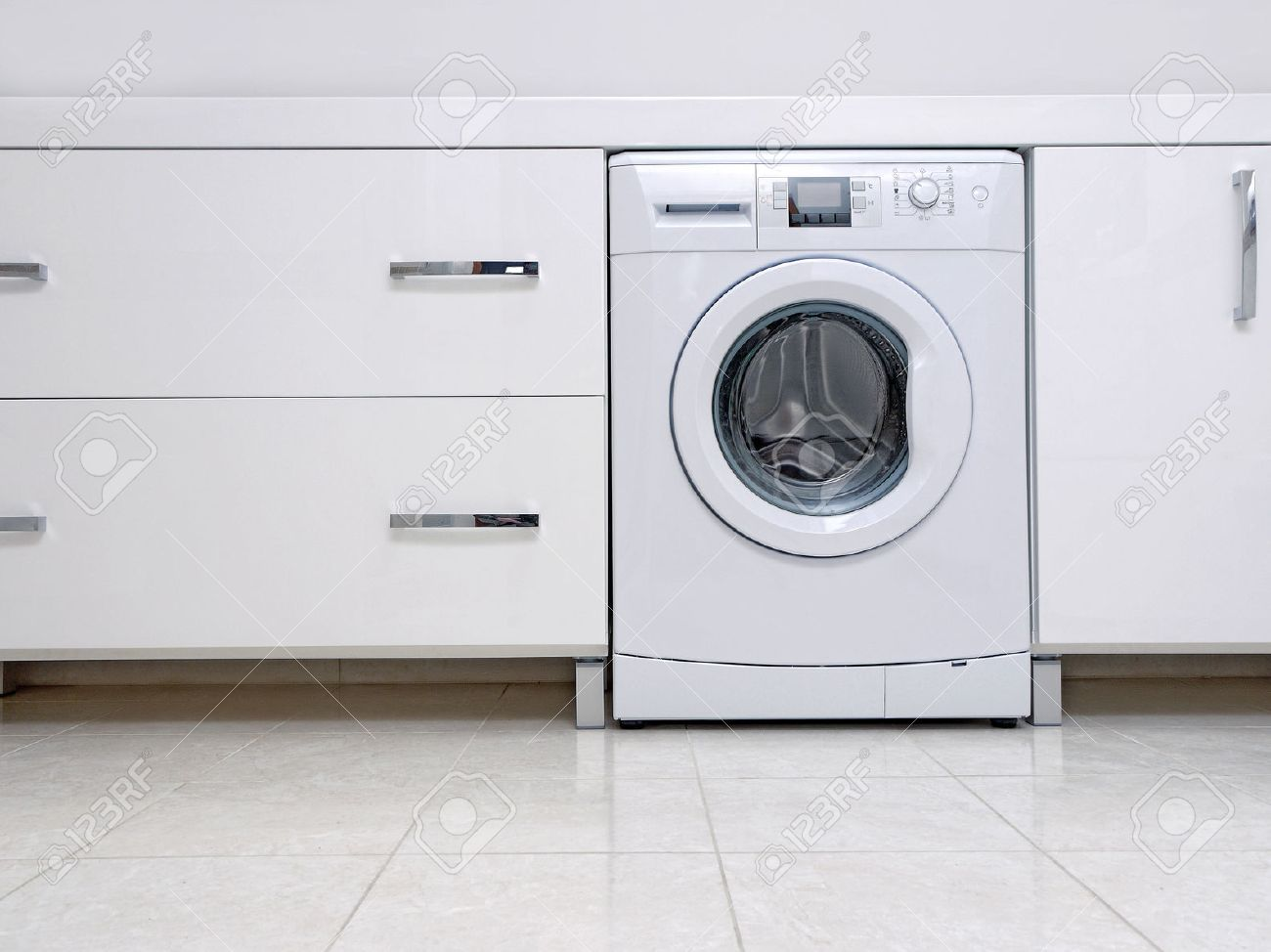 Row of white modern bathroom cabinets with built-in washing machine Stock Photo - 26054014