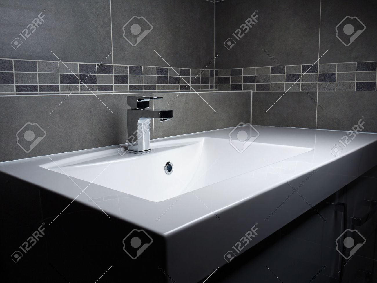 Exceptionnel Modern Bathroom Washbasin With Chrome Faucet And Gray Tiling Stock Photo    26054019