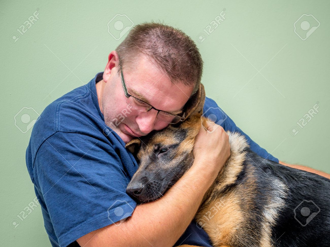 Young man hugging and consolating his dog Stock Photo - 31626641
