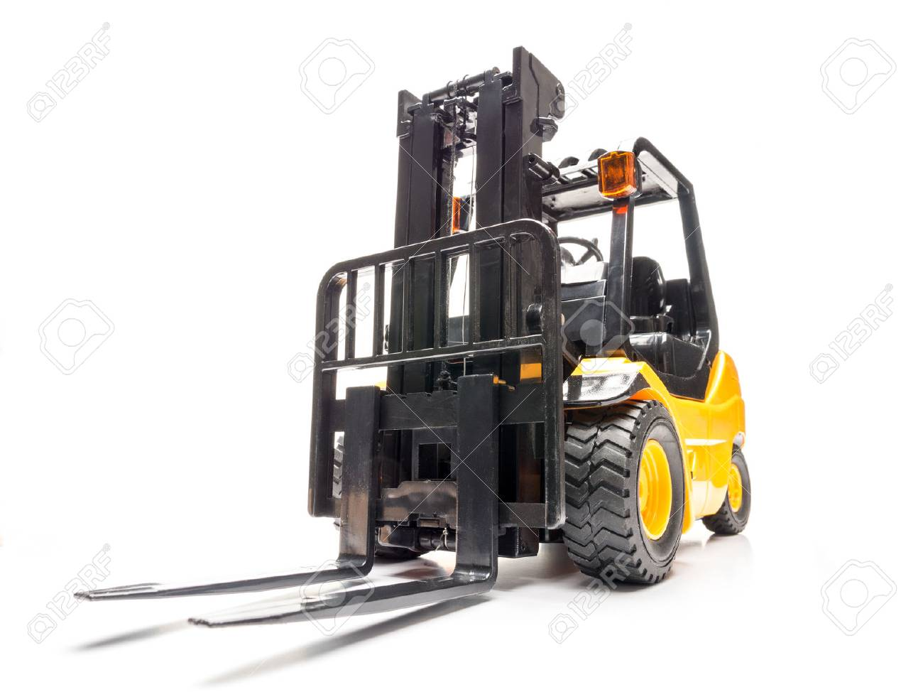 Yellow forklift truck shot on white background Stock Photo - 46182800