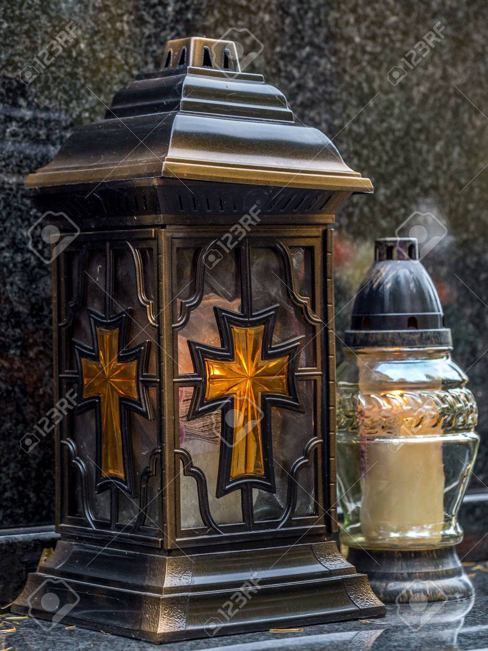 Votive candles lit on black marble tombstone stock photo picture stock photo votive candles lit on black marble tombstone arubaitofo Images