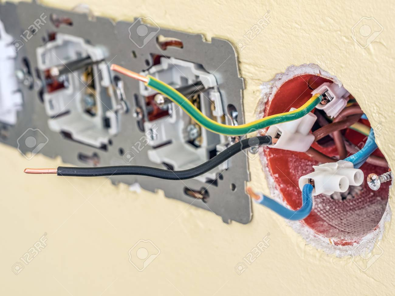 Closeup of partially embled wall socket with live, neutral.. on