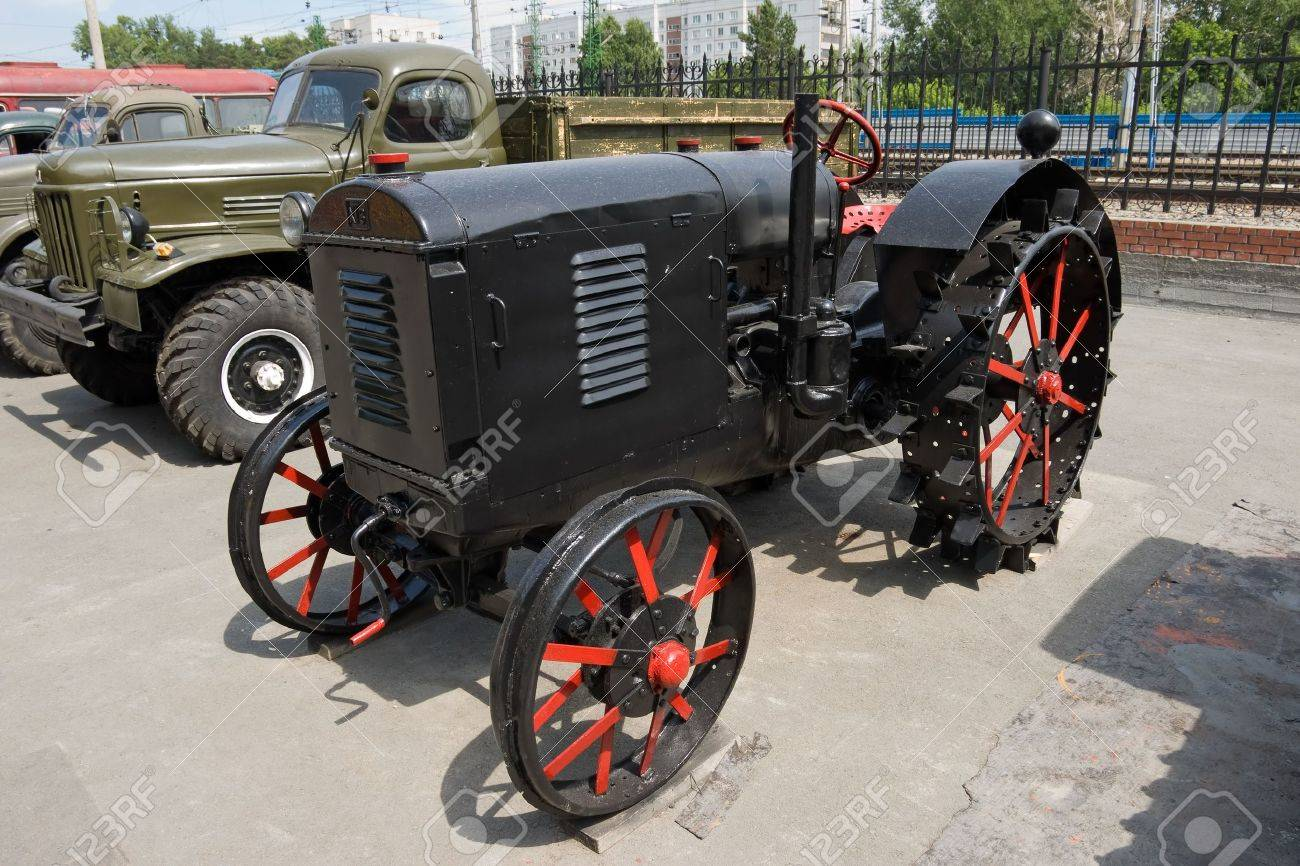 old fashioned tractor with iron wheel Stock Photo - 3442294