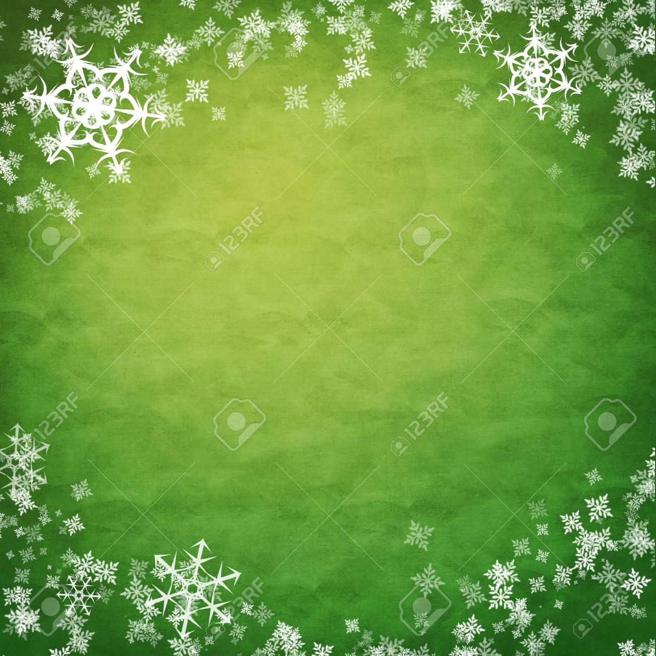 stock photo white showflakes over green cloth new year background